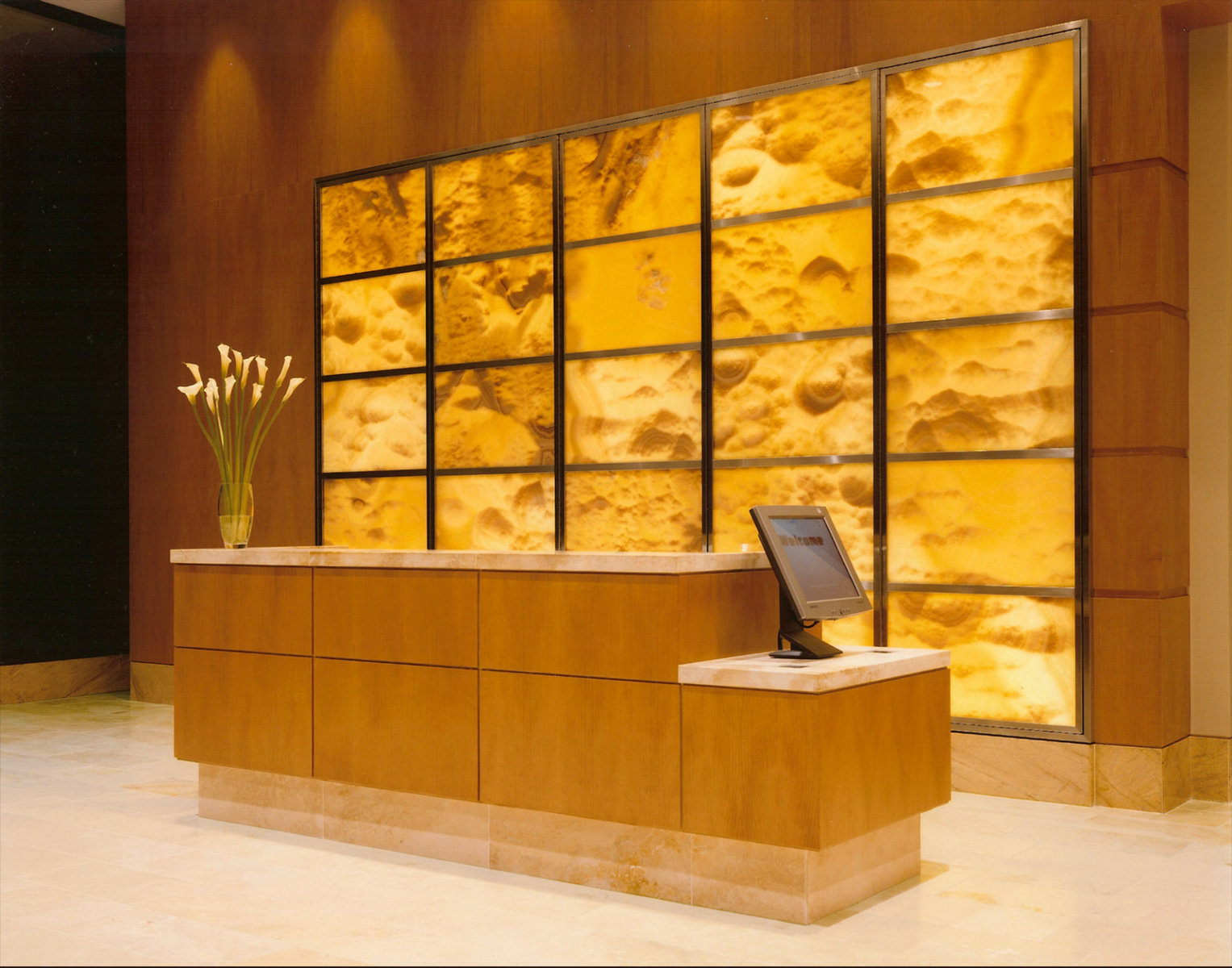 wood and travertine reception desk the wood paneling and stone floor ...
